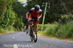 """There\'s that grimace (gurn) again. This stretch of road near the city of Dunedin is known as \""""The Wall\"""" and while it\'s only 24o meters long it has gradients of nearly 19% in parts. It hurts Photo credit: Mama Lazarou Photography https://www.facebook.com/Mama-Lazarou-Photography-Inc-123104847805880/"""